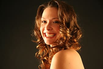 Smiling woman with curly blonde hair