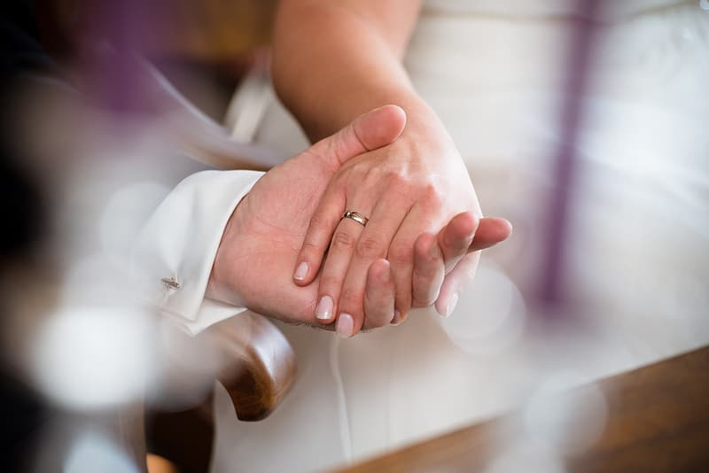 Tilt lens photography of two people holding hands