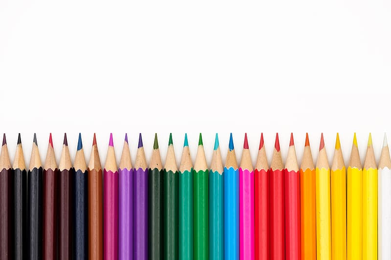 Multi colored coloring pencils on white background