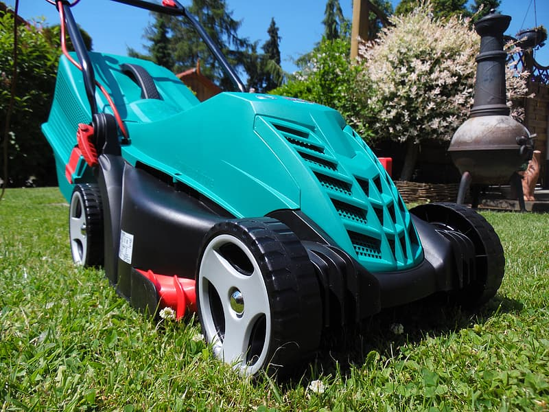 Blue and black ride on lawn mower