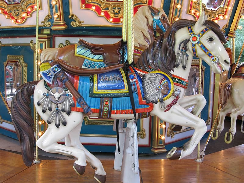 Close-up of horse carousel