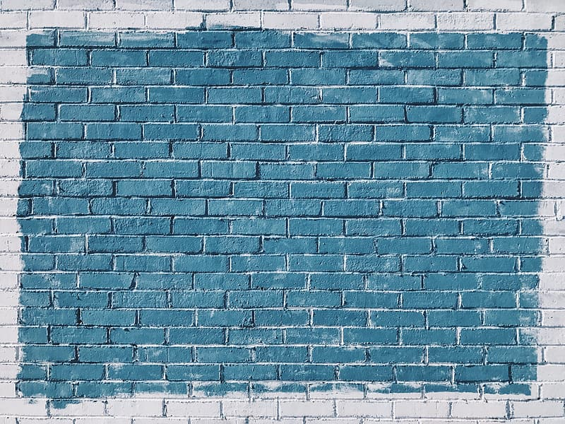 Gray brick wall with green painted center