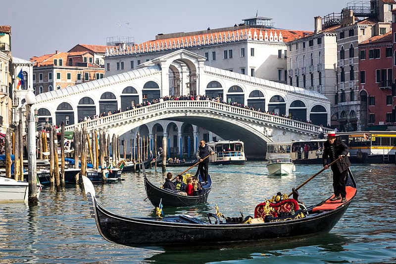 Two black canoes on Rialto Bridge, Italy