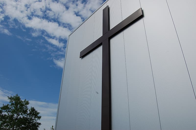 Low angle photography of cross statue