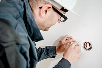 Man installing electric wire