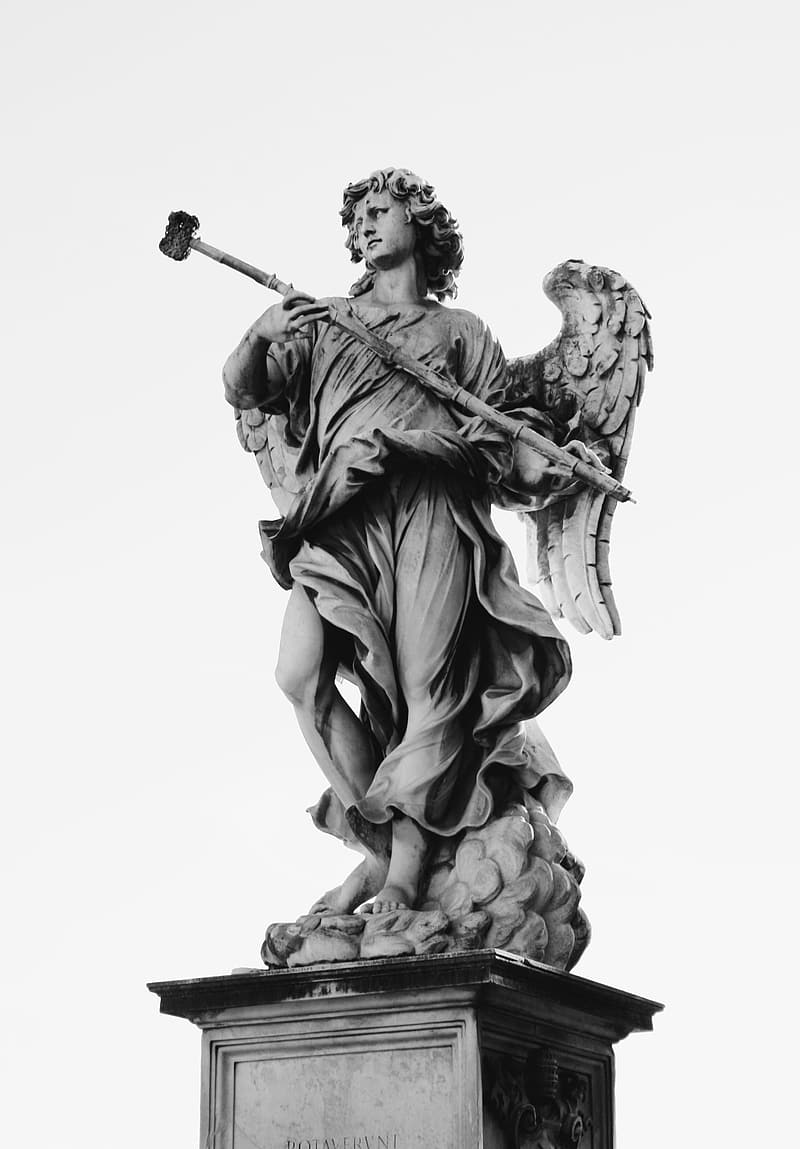 Grayscale photo of person holding stick statue