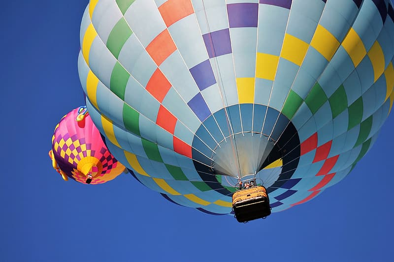 Two assorted-color hot air balloons bottom photo