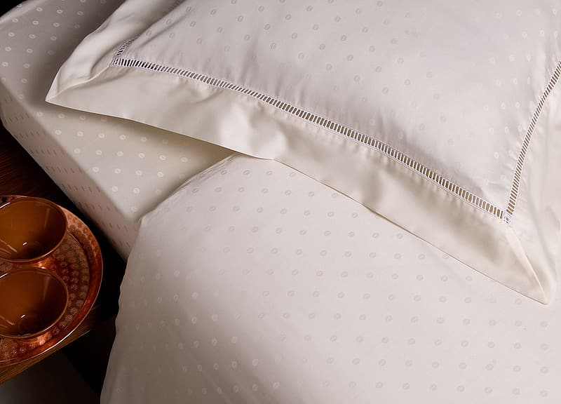 White pillow and comforter