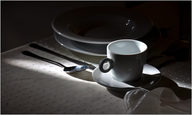 White ceramic cup and saucer on table