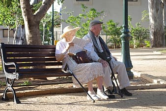 Old man and woman on wooden bench