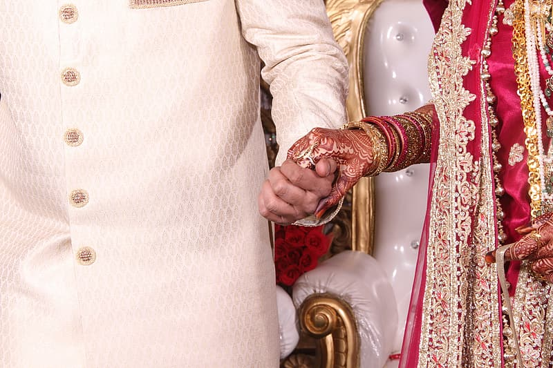 Man holding hand of woman