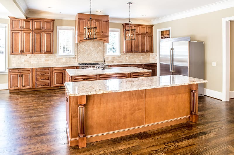 Photo of brown marble top brown wooden base kitchen island