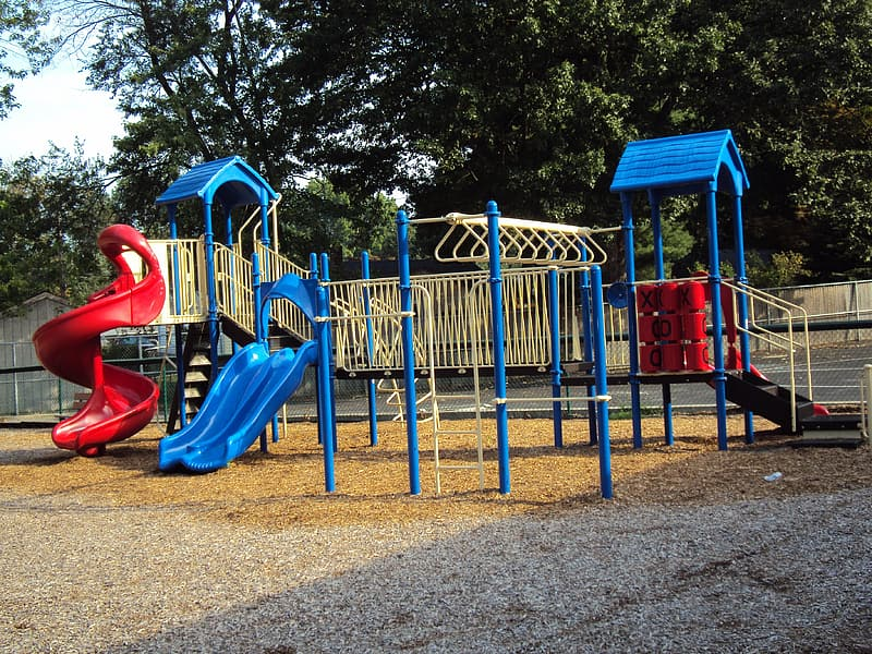 Empty blue and red slide and swing