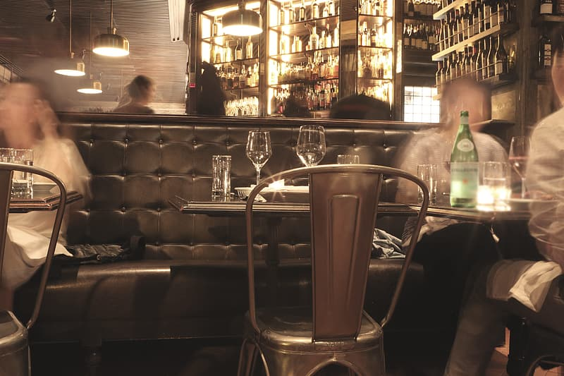 Stainless steel bar stools in front of table