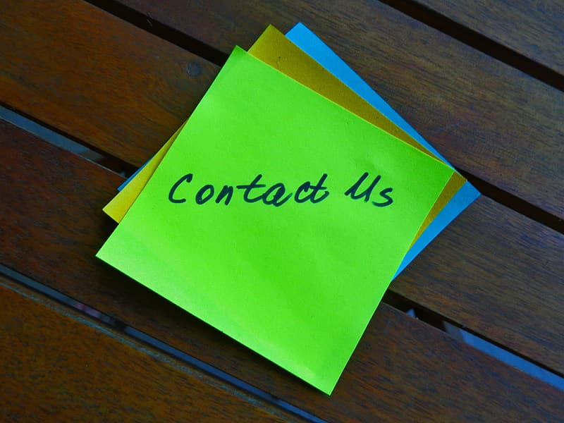 Green contact us printed sticky note