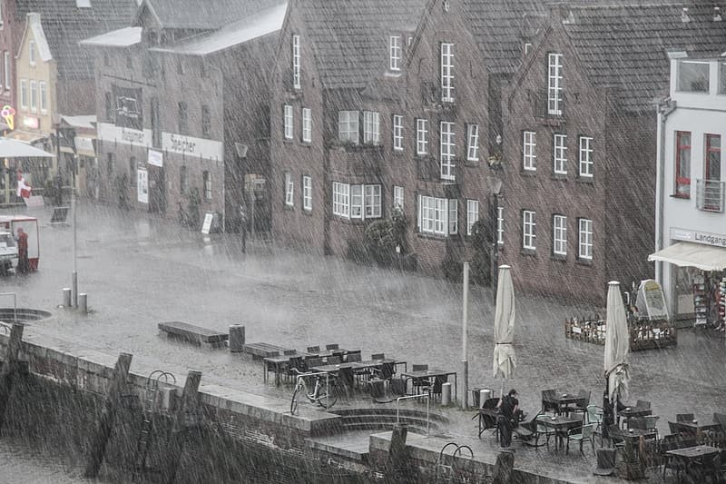 Building beside body of water during rainy day