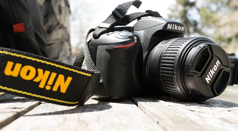 Closeup photography of black Nikon DSLR camera