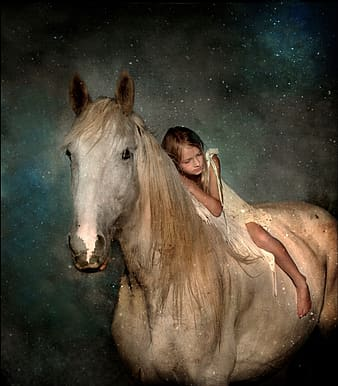 Girl riding on white horse