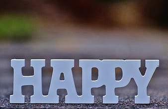 Happy text on concrete surface