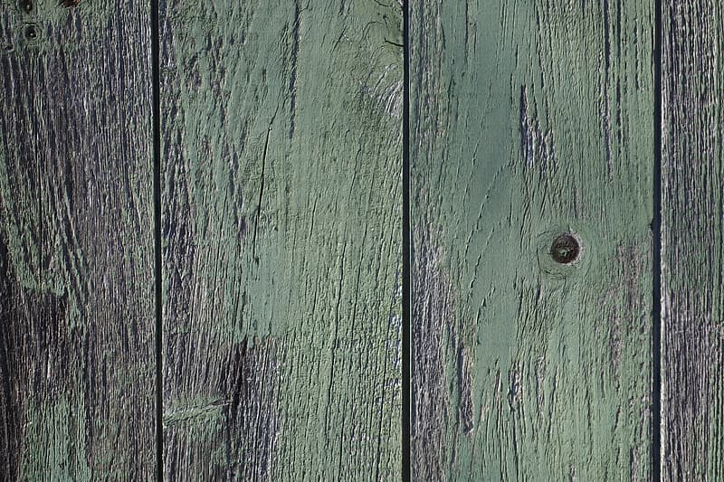 Green wooden board with hole