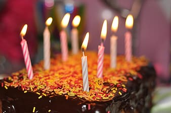 Close-up photography of chocolate birthday cake with candles top