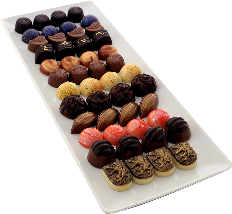 Chocolate candies on white plate