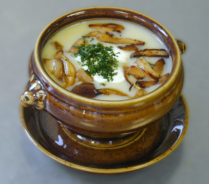 Cooked soup served on brown ceramic bowl