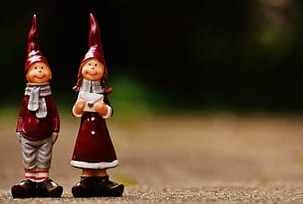 Red boy and girl ceramic figurines