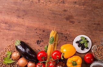 Assorted vegetables on brown wooden table