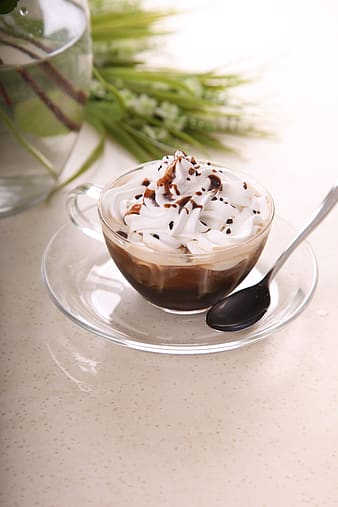 Clear glass cup filled with coffee with cream