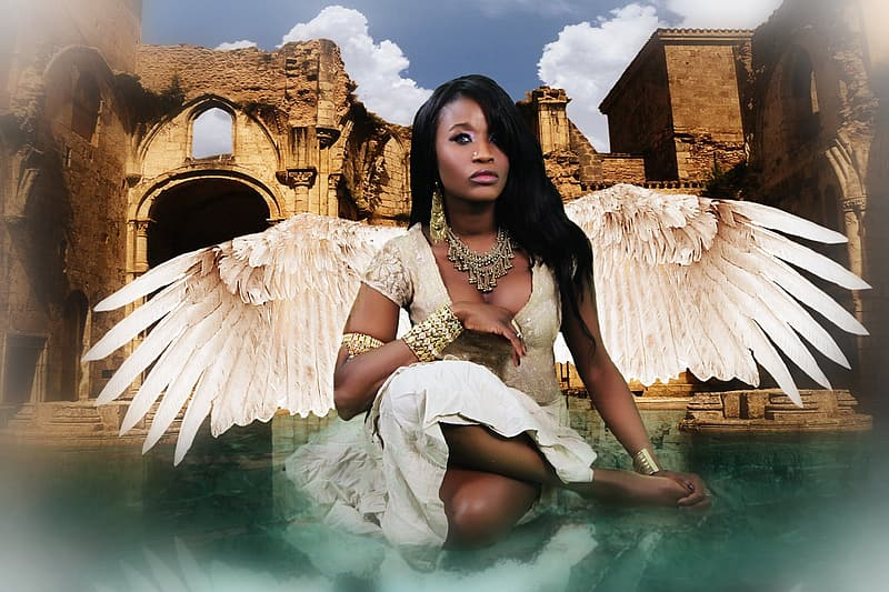 Woman wearing white dress and wings
