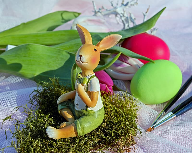White and green dressed brown bunny ceramic figurine