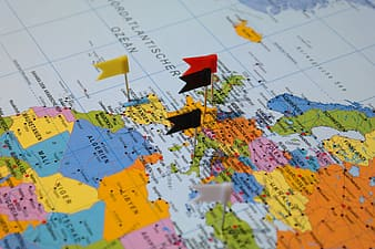 World map with flag pin