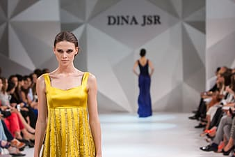 Woman in yellow scoop-neck gown