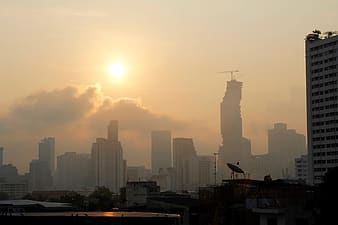 Skyline of a city with the sun setting