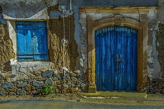Blue wooden door with white rope on top