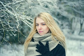 Blonde woman in black and gray star print sweater