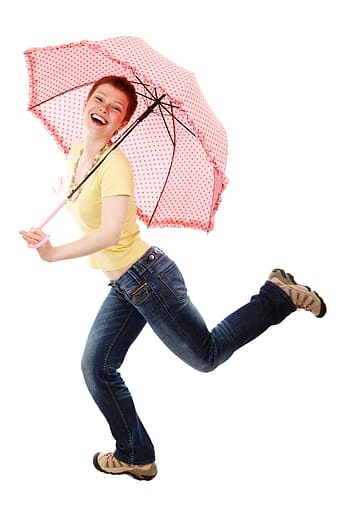 Photo of woman wearing yellow scoop-neck shirt holding red umbrella