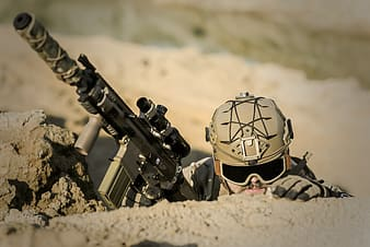 Man holding gray tactical rifle
