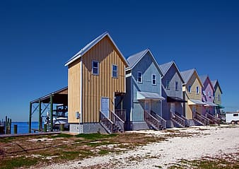 Six assorted-color painted houses near sea
