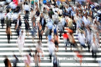 Panning photography of group of people on pedestrian lane