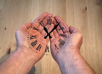Analog clock at person's hand