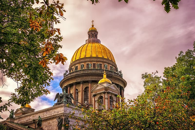 Yellow and brown dome building under white clouds and blue sky during daytime