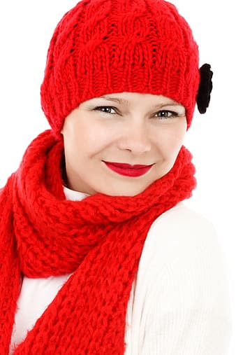 Woman wearing white shirt with red crochet hat and crochet scarf portrait photo