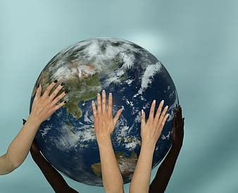 Human hands holding earth scale model