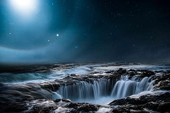 Time lapse photography of water falls during night time