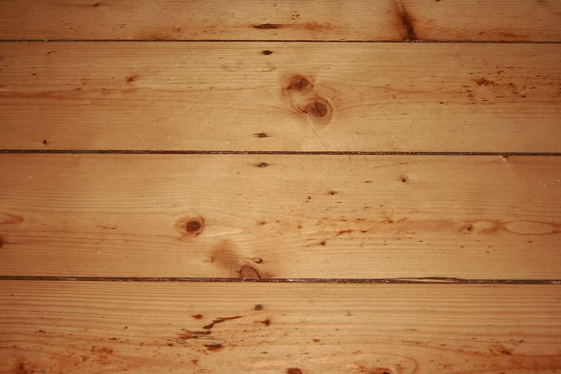 Brown wooden plank with hole