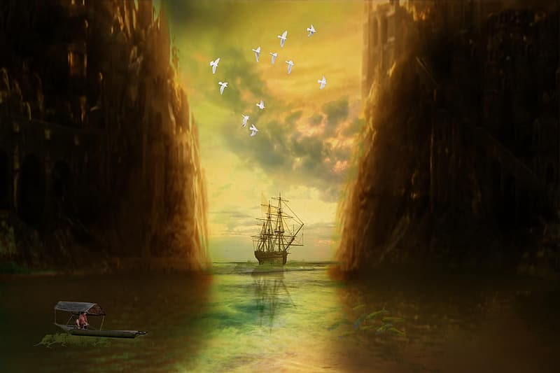 Galleon ship on body of water during sunset
