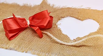 Red ribbon on brown textile