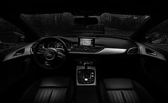Grayscale photo of vehicle interior